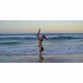 Handstanding in Rainbow Beach